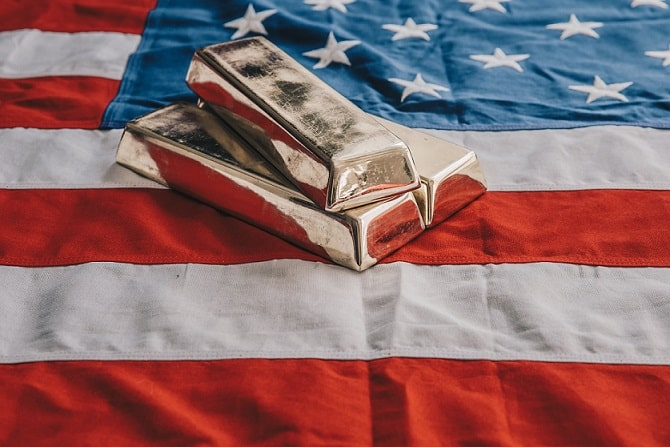 gold-bars-on-an-american-flag